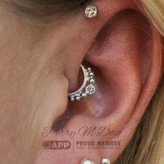 "Daith piercing featuring a white gold and white sapphire ""Dione"" ring from…"