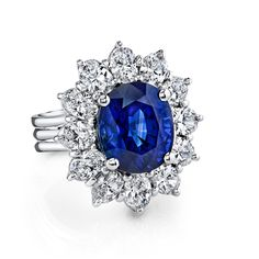 """From the Gelato collection an oval-shape Sapphire of 9.91 cts. sits at the center of this 18k white gold ring decorated ovalr-shape diamonds. :Assert yourself with a gleaming ring that demands to be seen! """""""""""""""