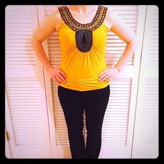Boho Chic Top Size medium. Worn, but in ok condition. Pull on sleeve (see photo #4). Lots of intricate design in front and comfy fabric. 94% rayon and 6% spandex. Romeo & Juliet Couture Tops Tank Tops