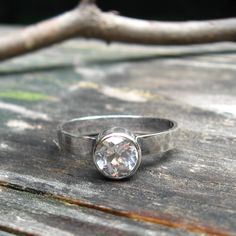 White Topaz Ring ... 6mm white topaz gemstone oxidized sterling silver hammered band stackable. $48.00, via Etsy.