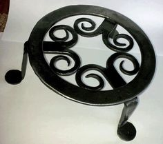 """Hand forged trivet from 3/16 x 3/4 stock. Ring is about 6 1/2"""" in diameter, stands about 3 1/4"""" tall. Finished with a clear lacquer"""
