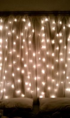 Overlaying a sheer curtain with string lights creates a gauzy effect that will turn any room into a dreamy hideaway.