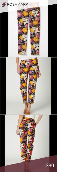 """Anthropologie floral pants Tropica Crops by Elevenses Elevenses' above-the-ankle poplin slims are covered in brilliantly colored blooms.   Front, back welt pockets  Cotton  Machine wash  29"""" L and 18.5"""" waist Anthropologie Pants Ankle & Cropped"""