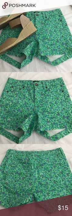 JCrew Floral stretch denim, high waisted shorts. Beautiful and worn maybe twice. Great bright color and great fit. High waisted, stretch denim material. Green in overall color, with blue, white, and purple flowers detail. J. Crew Shorts Jean Shorts
