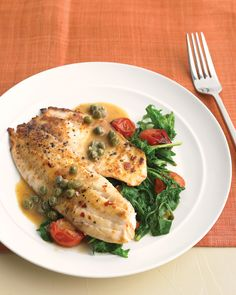 Tilapia with Arugula, Capers, and Tomatoes: Economical tilapia gets dressed up with a buttery caper sauce. Serve with a spicy side dish of sauteed arugula and cherry tomatoes.