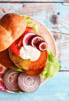 bean & millet vegan burgers with salami, veggies and mayo