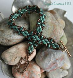 Created this design using Deborah Roberti's Harmony Band tutorial.  I used Copper Picasso-Turquoise and Metallic Suede-Light Green Superduos embellished with Copper Toho Beads.  Love how this turned out!!