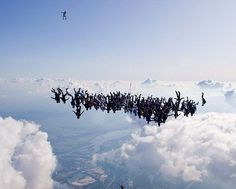 Fall guy: One of the skydivers, seen further below the throng, appears to have got rather ahead of the rest as they begin to link up Cool Pictures, Cool Photos, Amazing Photos, Adrenaline Sports, Nepal Mount Everest, Rock Climbing Gear, Hang Gliding, Bungee Jumping, Paragliding