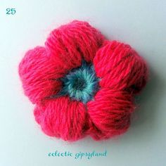 "A fun flower that would add a little extra ""oomph"" to a crochet project.  I just love the ""puff""."