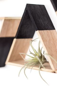 DIY these mini triangle shelves with wood to display decor on your wall. They are super easy to make and look too cute! #diy #homedecor