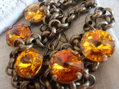 Topaz/Sunflower Swarovski crystals Antique by ParisiJewelryDesigns, $40.00
