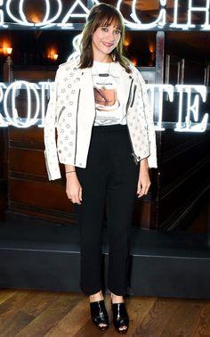 Rashida Jones in a white Coach leather jacket, t-shirt, black pants and mules