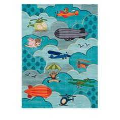 Let your imagination take off: our sculpted Flying High Indoor Area Rug invites a colorful collection of flying machines and puffy clouds (plus one flying pig!) to take the floor of your child