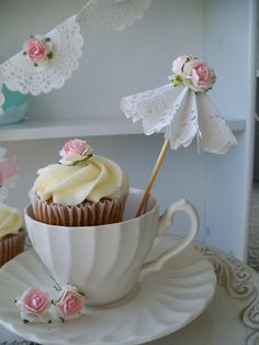 Ideas for paper doilies - sweet paper parasol and banner. The cupcake is sweet too! Party Kulissen, Tea Party Birthday, Party Ideas, Baby Birthday, Party Favors, Cupcake Toppers, Cupcake Cakes, Teacup Cupcakes, Tea Party Cupcakes