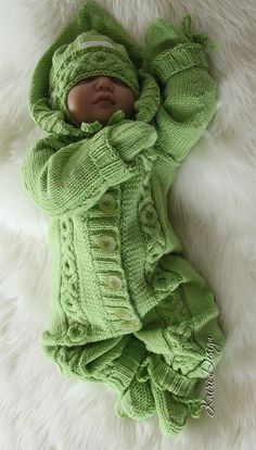Knitting Pattern for Hugs and Kisses Baby Onesie - This all-in-one hooded romper features an xoxo cable pattern to wrap your little one in love. Sizes0 – 3 months ; 3 – 6 months ; 6 – 9 months ; 9-12 months. Aran weight. Designed by Kairi Design