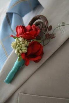 button hole with aqua ribbon