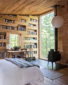 The interior has a large, floor-to-ceiling picture window and a window placed above the desk. Cabin Design, Tiny House Design, Cabin Interiors, Secret Rooms, Maine House, Small Spaces, House Plans, New Homes, Home Decor