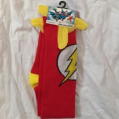 The Flash Knee-High Socks Fun and comfy The Flash knee-high socks featuring his emblem and Crimson-Comet-esque lightning bolts on both sides of each socks' tops! I bought these and another pair because I was cold, but I only used the second pair. These are super soft and do not appear to have any defects. Perfect for the superhero in disguise or, if you're feeling less bold, a gift for that Flash fan in your life! NWT and never worn! Offers welcome! ❤️⚡️ Bioworld Accessories Hosiery & Socks