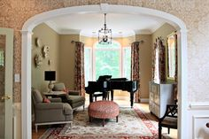 Probably the best set up for piano with mirror and credenza on facing wall to entry and the two chairs as shown. Use desk un family room.