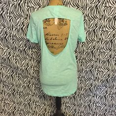 Victoria Secret Pink Top W/Cutout In Back NWT Super cute mint VS Pink top with cutout in back in perfect condition! Dog Graphic on front! Bundle and save 30% on 3+ items!!! PINK Victoria's Secret Tops Tees - Short Sleeve