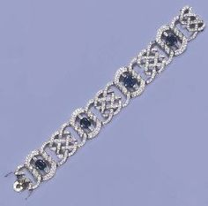 A BELLE EPOQUE SAPPHIRE AND DIAMOND BRACELET Of flexible openwork design, the four pavé-set diamond oval links with cushion-shaped sapphire and baguette-cut diamond centres to the diamond lattice-work spacers, circa 1910, 17.6 cm. long, with French assay mark for platinum