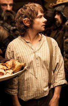 The Hobbit. I love how Bofur is carrying a plate on his head! :)