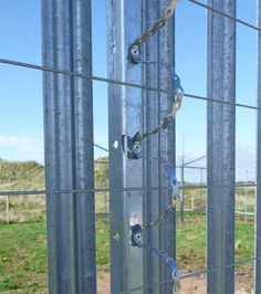 Anti-spread detector made of galvanized steel arching over electric fencing wires installed on military base perimeter for detection of any attempt to spread the wires. Electric Fencing, Perimeter Security, Wildlife Park, Galvanized Steel, Zombie Apocalypse, Property Management, Wind Chimes, Security Fencing, Fence