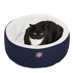 20-inch Blue Cat Cuddler Pet Bed by Majestic Pet Products. Machine washable cover has a Poly/Cotton Twill shell with a sherpa inner lining, and covers a cushion of orthopedic grade foam. Dimensions 20-inch Diameter/1.5-inch Thick
