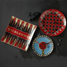 Assorted Board Game Plates designed by Two's Company. Made 0f Glass / Gold Foil. These would be a good addition for your study or living room. Gives the room that classy and expensive look. http://www.zocko.com/z/JG9P1