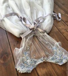 Купить или заказать Лед почти растаял в интернет-магазине на Ярмарке Мастеров. Платье состоит из двух частей. Нижнее платье из натурального шелкового крепдешина голубого цвета с лавандовым оттенком на подкладе из хлопка-шелка натурального нежно-сливочного цвета. Застежка на спине от талии на молнии.. Верхняя часть платья - тонкое фатиновое платье молочного цвета, расшитое бисером, пайетками, стеклярусом, с застежкой на пуговки на талии и спине, шлейф пыльного серого цвета с серебристыми…