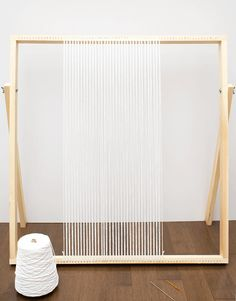 Warp your loom with cotton yarn.