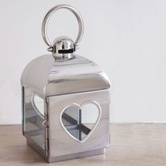 This beautiful stainless steel lantern has a single heart design for a romantic feel.