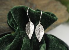 Sterling Silver Rose Leaf Delicate Earrings. These romantically simple, lightweight earrings are cast from real rose leaves, oxidized to