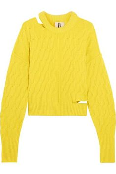Seen on the runway this September, Topshop Unique's yellow sweater pays homage to the eclectic spirit of '80s London. This cozy style is knitted in a cable pattern and finished with subtly distressed cutouts. We like how the exaggerated ribbed cuffs add volume to the sleeves.