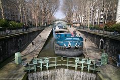 Boat passing a lock, Canal St-Martin