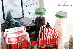 A vintage inspired hot cocoa station for the holidays. Cute ideas for a Christmas display! Love the old Santa mug, vintage camera and plaid school lunchbox!