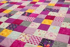 A pure cotton quilt in rich purple and pink berry colours. Interspersed with cool grey tones and a few pops of yellow to give the quilt a little dash of sunshine. The back is grey featuring drag… Pink Wallpaper Iphone, Online Gratis, Quilting Tutorials, Cotton Quilts, Bed Sheets, Quilt Blocks, Hand Embroidery, Quilt Patterns, Patches