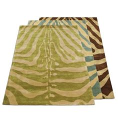 Serengeti Zebra Print Area Rug - Simple Animal print rugs in dark brown stipes to balance out the green in the animal print pillows and bring in the dark wood furniture