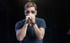 """Rob Thomas found his sweet spot at PNC Music Pavilion on Wednesday night: Right in the shadow of the support columns. """"It's almost oppressively hot, like the kind of heat that's…"""