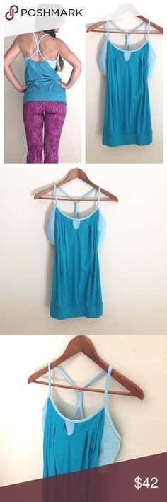 """Lululemon No Limits Workout Top Lululemon No Limits Workout Top! Women's size 10. Gently used and in great condition with no snags/stains on material. Built-in bra. No bra padding. Light blue color with blue/white stripe bra. Loose fit with band at hip for a flowy feel.   Length: 28"""" Size: 10  🔸10% off bundles of 2 or more items 🔸No Trades 🔸Reasonable offers accepted 🔸Fast Shipping  Please comment with any questions! lululemon athletica Tops"""