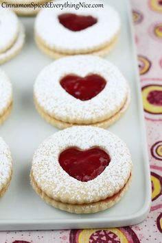 Cookie tartlets with little red peek-a-boo heart cut-outs! Perfect for an Alice in Wonderland party.