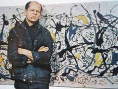 Jackson Pollock posed in front of 'Summertime: Number 9A' for LIFE in 1949