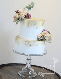 Rustic two tier white and gold wedding cake with fresh flowers. www.cookiedelicious.co.uk