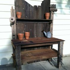 Potting shed my husband built out of barn siding. I told him he could make these on the side.