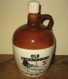 "What a funny stoneware whisky jug! Features a hillbilly climbing out of a coffin and expressions like, ""Aged in the wood,"" ""A friendly spirit"" and ""You can't keep a good whiskey down."" Perfect for moonshiners, hillbillies, rednecks and whiskey drinkers! #whisky #hillbillies #jugs"