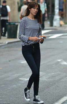 This outfit is casual and still chic. The top and jeans make it put together while the Converse tones it down and makes it a bit more causal.