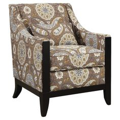 Upholstered arm chair with a medallion motif.   Product: ChairConstruction Material: Wood and fabricColor:...