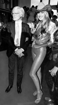 Andy Warhol and Jerry Hall at the Urban Cowboy Premiere in 1980