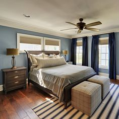 Adding hits of blue to master bedroom - love the pinstripe rug, relaxed bedding and those cube ottomans are perfect.