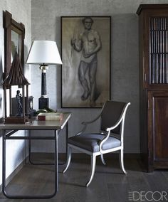 The guest room's French table and drawing date to the early 1900s, and the circa-1810 bookcase is Italian.   - ELLEDecor.com